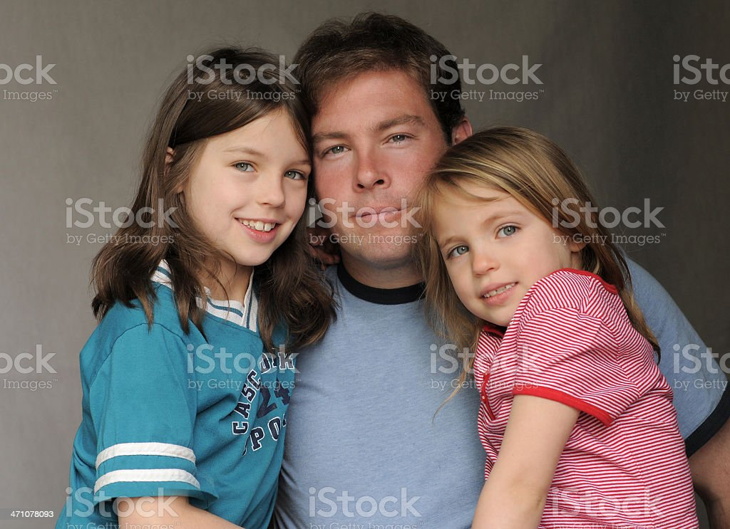 Two girls and their dad royalty-free stock photo