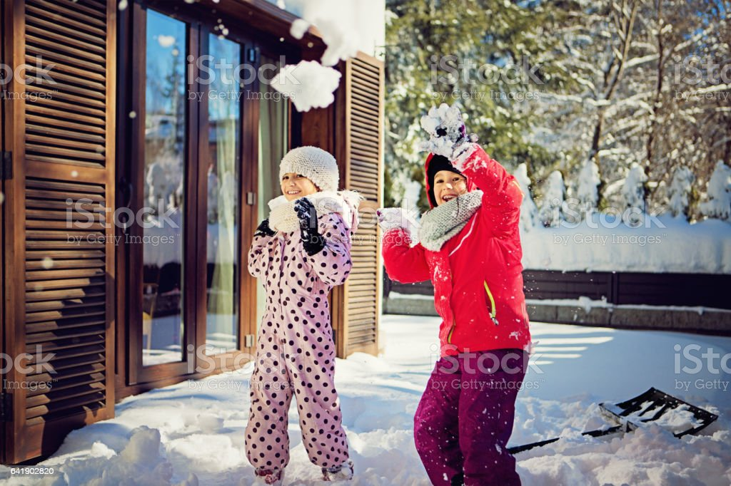 Two girls are playing in the snow - Photo