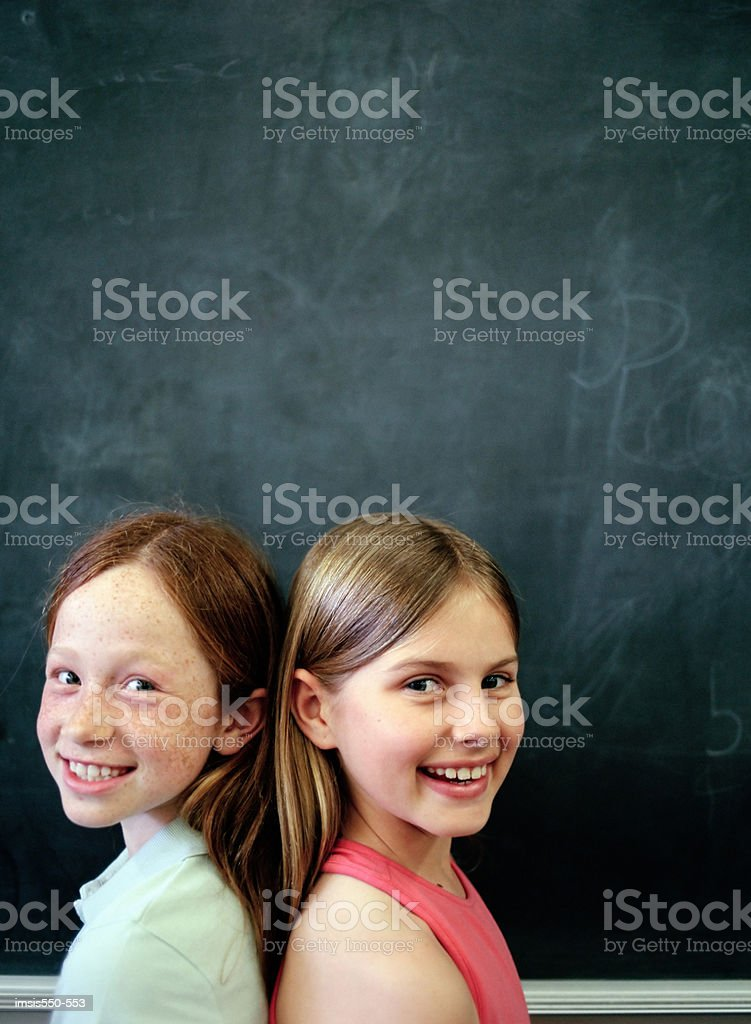 Two girls by blackboard royalty-free 스톡 사진