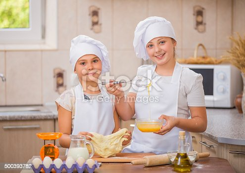 488109116istockphoto two girls cook 500393782