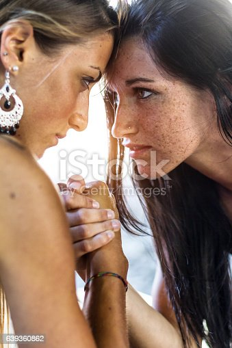 Two girls doing arm wrestling outdoor