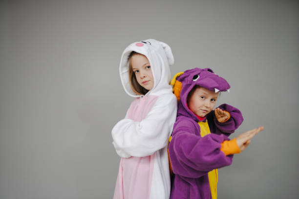 two girls dressed as rabbit and dragon posing stock photo