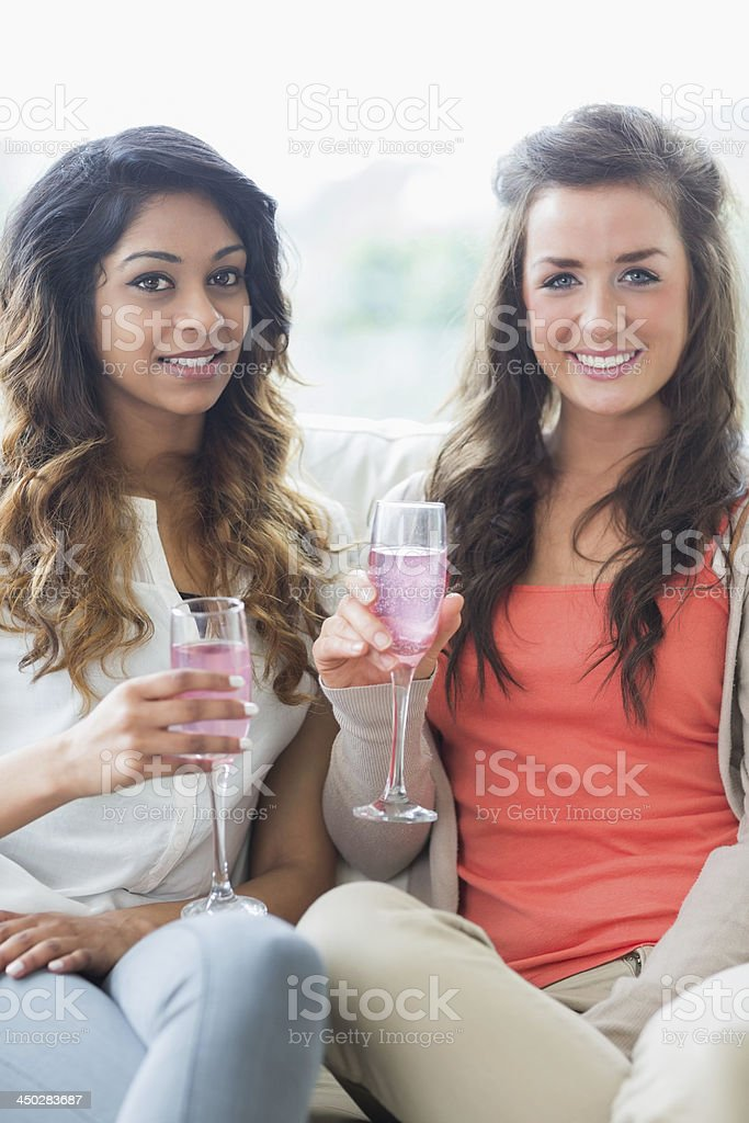 Two girls drinking champagne stock photo