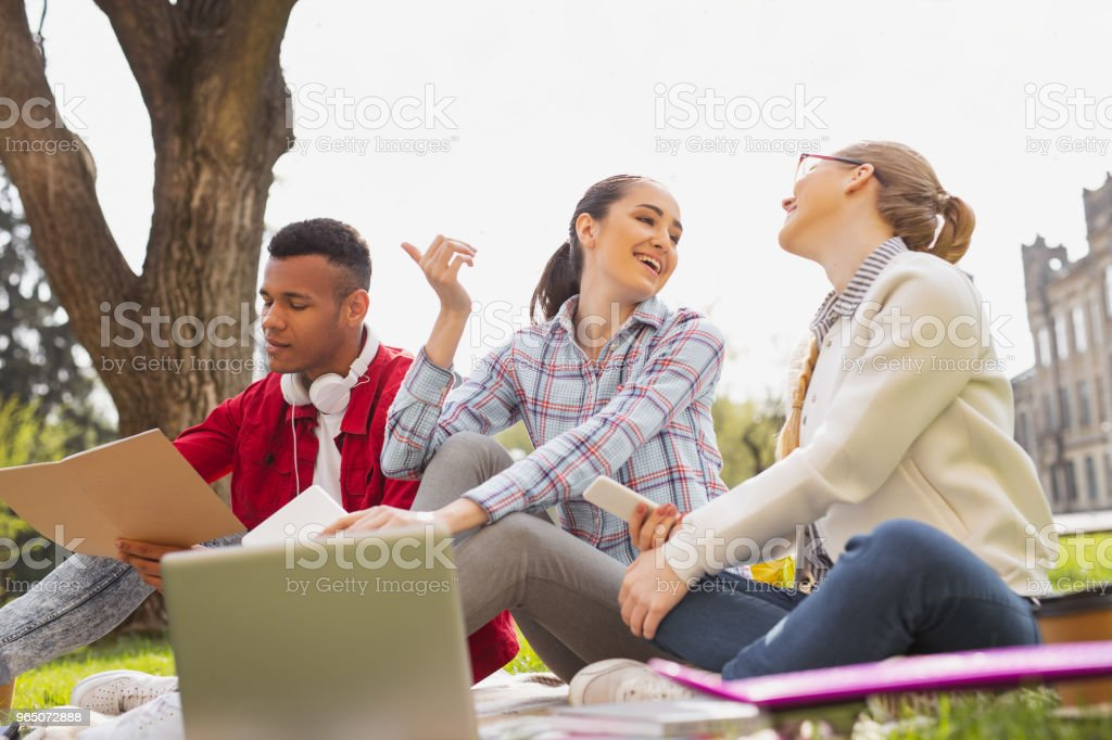 Two girls feeling unbelievable discussing positive news zbiór zdjęć royalty-free