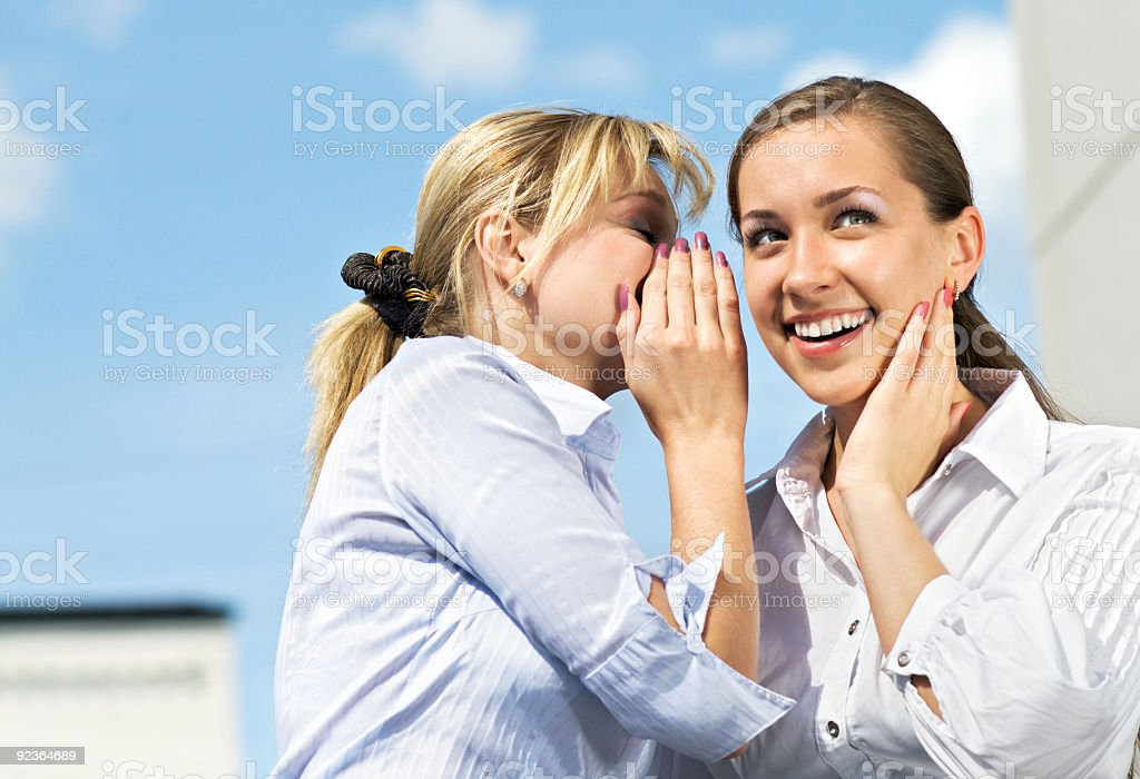 Two Girls Gossiping royalty-free stock photo
