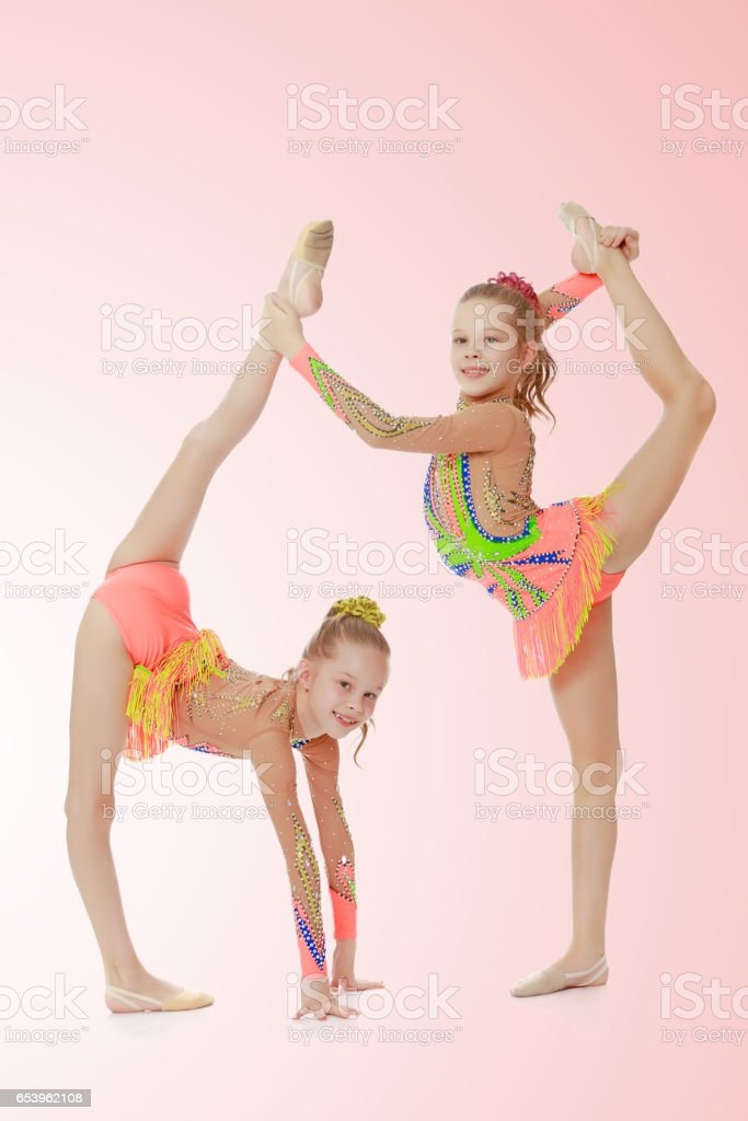 Two Girls Gymnast Sitting On Splits Stock Photo Download Image Now Istock