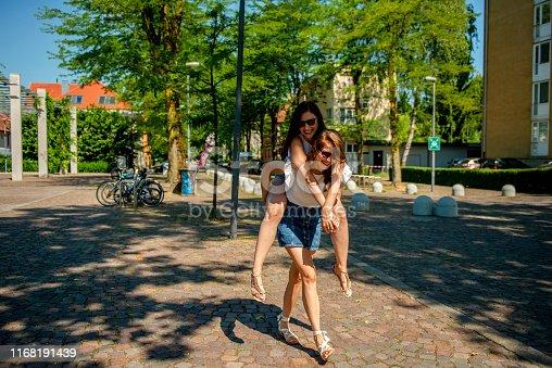 istock Two girls having fun in the city 1168191439