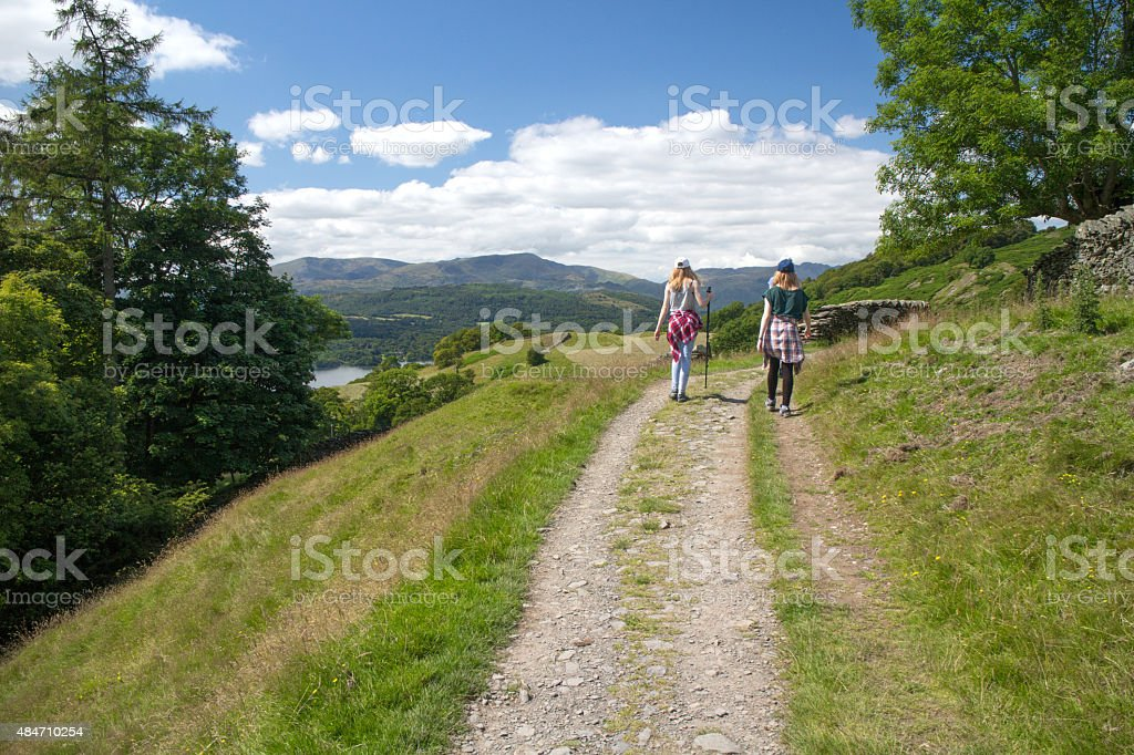 Two girls hiking in the Lake district. stock photo