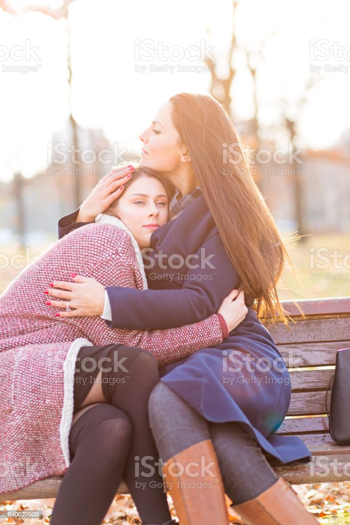 Two girls hugging stock photo
