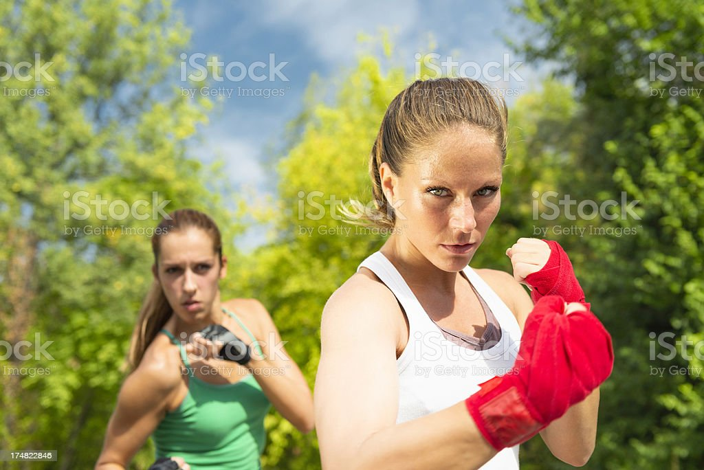 Two girls in a fighting stance royalty-free stock photo