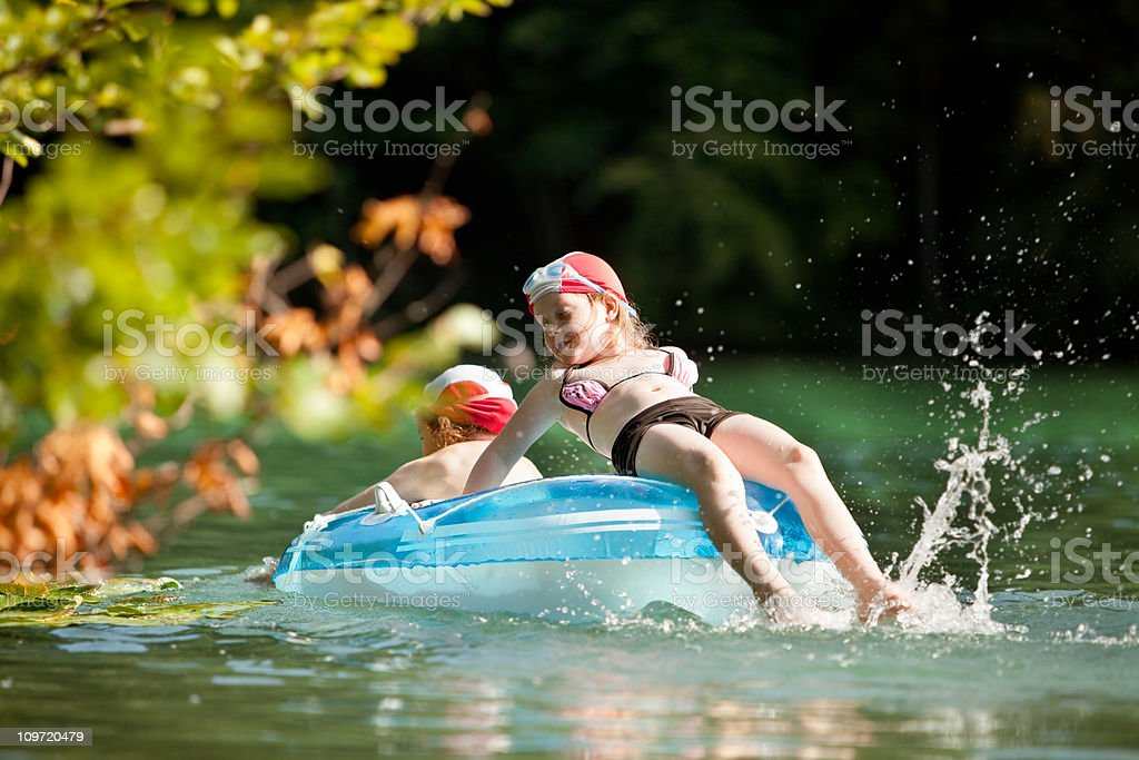 Two girls in a rubber dinghy royalty-free stock photo