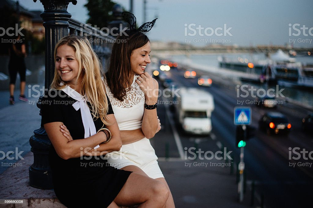 Two girls in costume after party stock photo