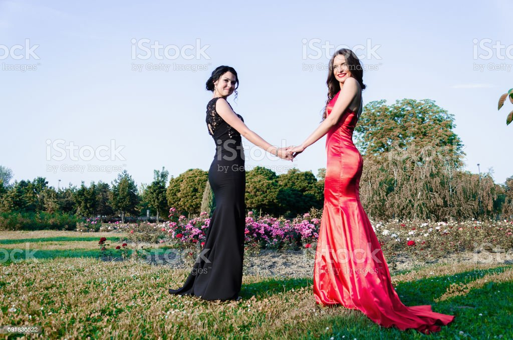 two girls in dresses couple stock photo