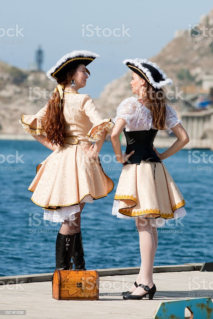 Two girls in pirate costumes outdoors royalty-free stock photo