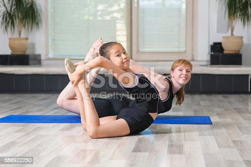 466808392 istock photo Two girls in the gym 586922250
