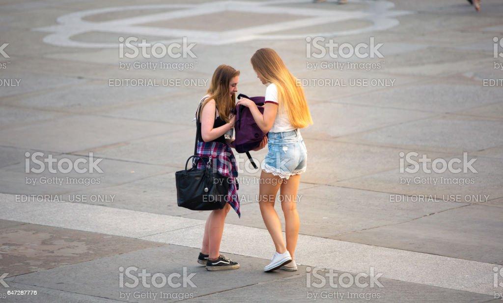 Two girls in Trafalgar square. London stock photo