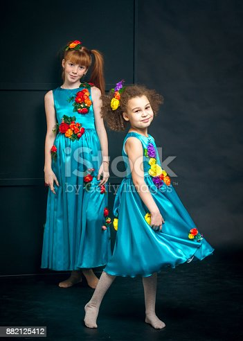 istock Two Girls in Turquoise Dresses 882125412