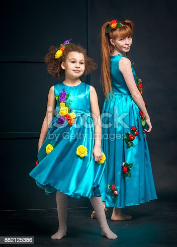 istock Two Girls in Turquoise Outfits 882125386