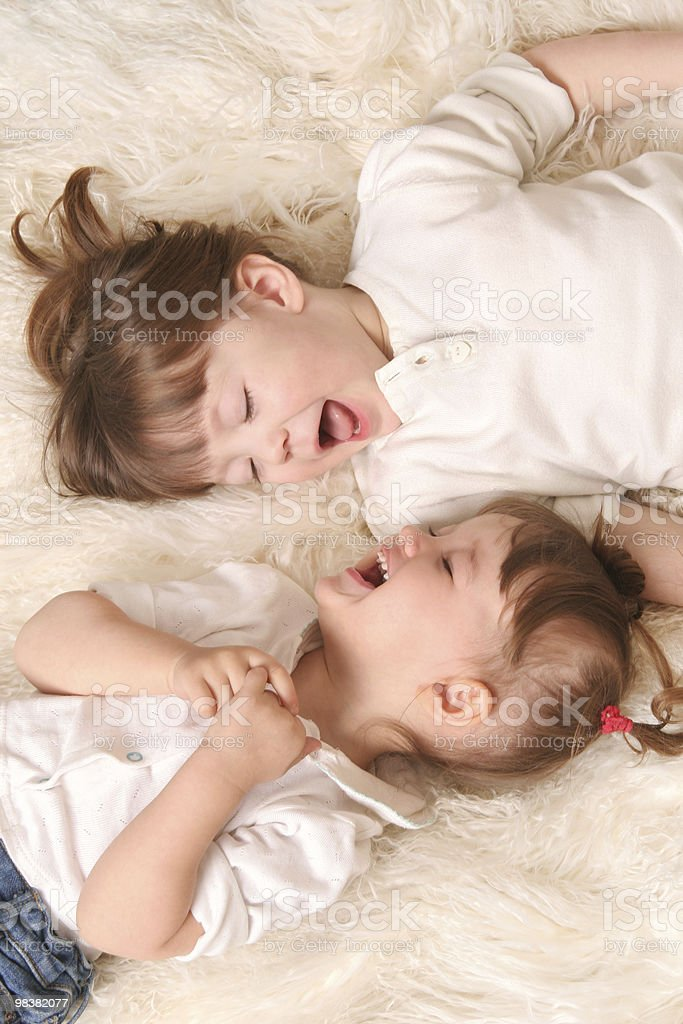 Two girls laughing stock photo