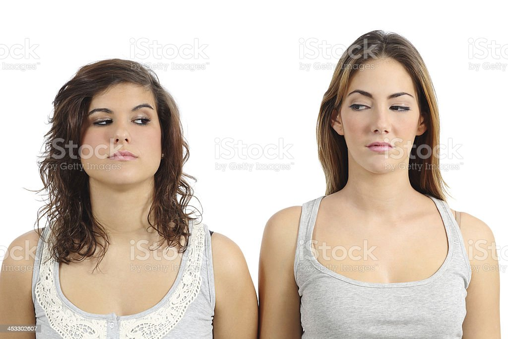 Two girls looking each other angry stock photo