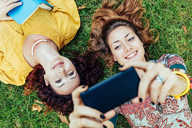 Two girls making selfie stock photo