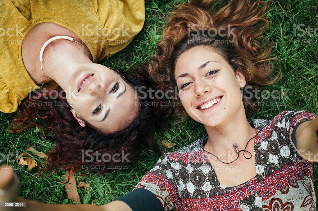 Two girls making selfie stock photo