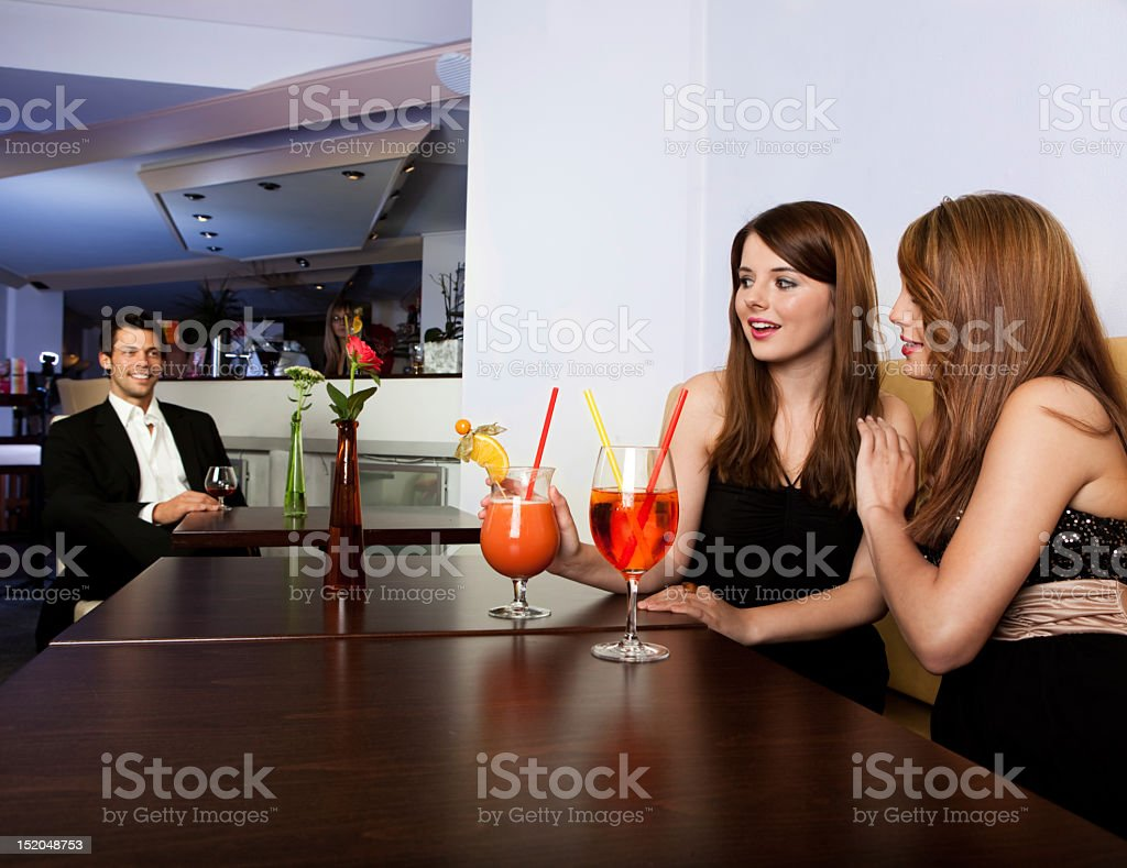 Two girls noticed young man royalty-free stock photo