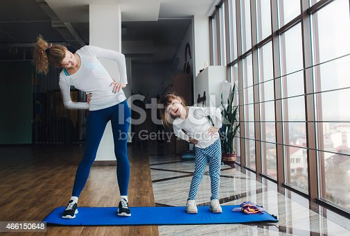 istock Two girls of different ages makeing yoga 466150648