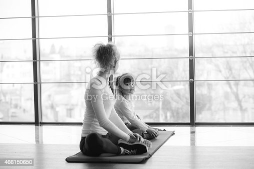 istock Two girls of different ages makeing yoga 466150650
