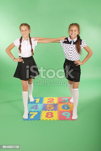 693519466 istock photo Two girls on rug with numbers 864683108