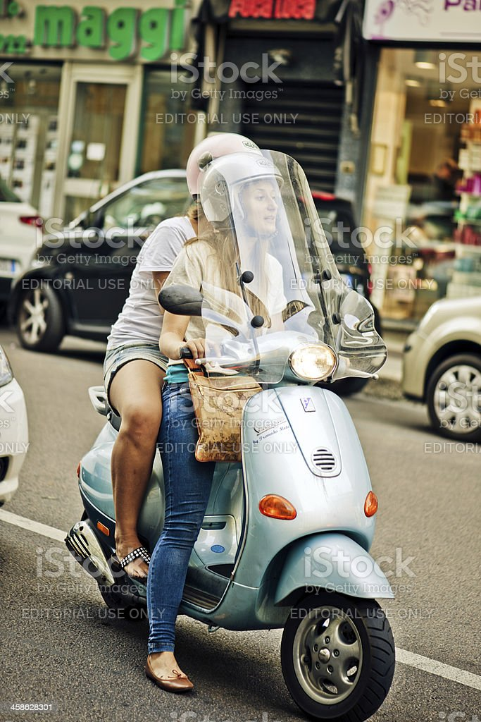 Two girls on Vespa in Milan royalty-free stock photo
