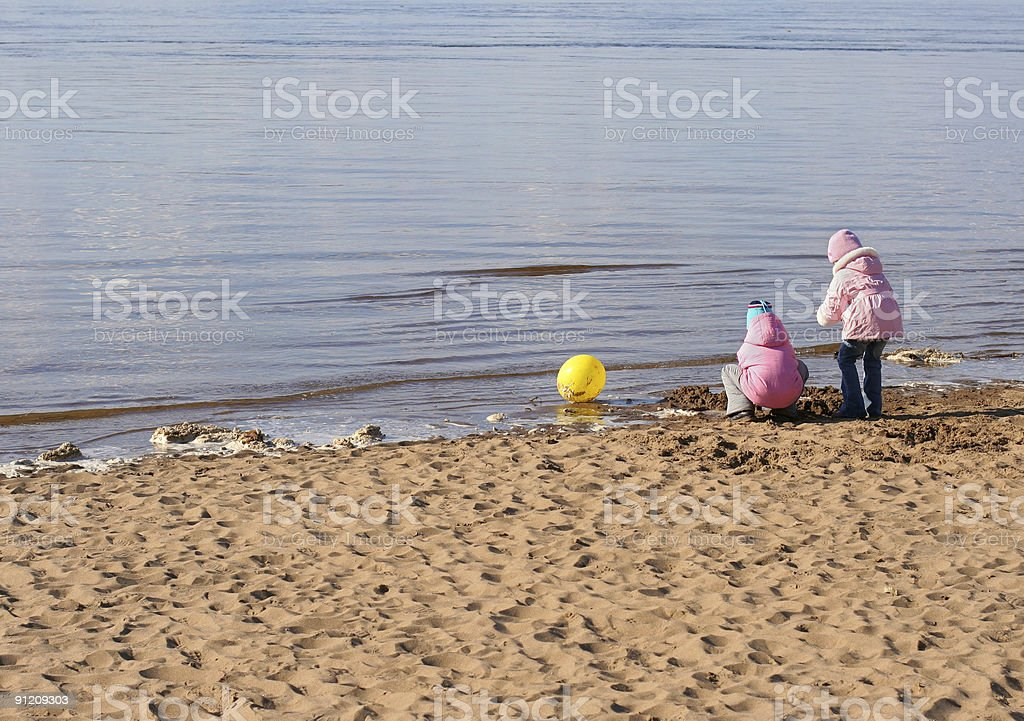 two girls play on the beach royalty-free stock photo