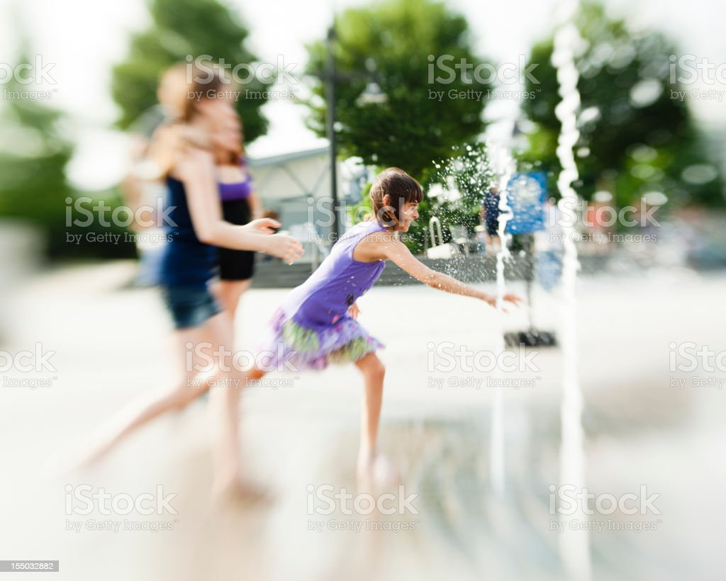 two girls play with fountain royalty-free stock photo