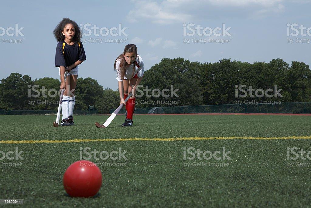 Two girls playing hockey royalty-free stock photo