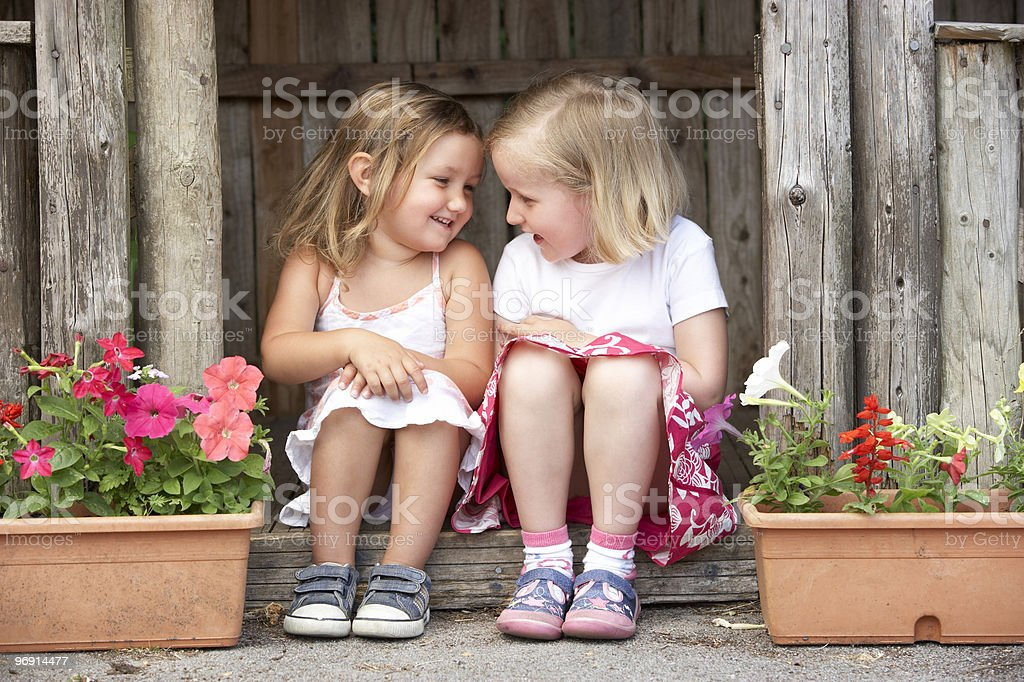 Two Girls Playing in Wooden House royalty-free stock photo