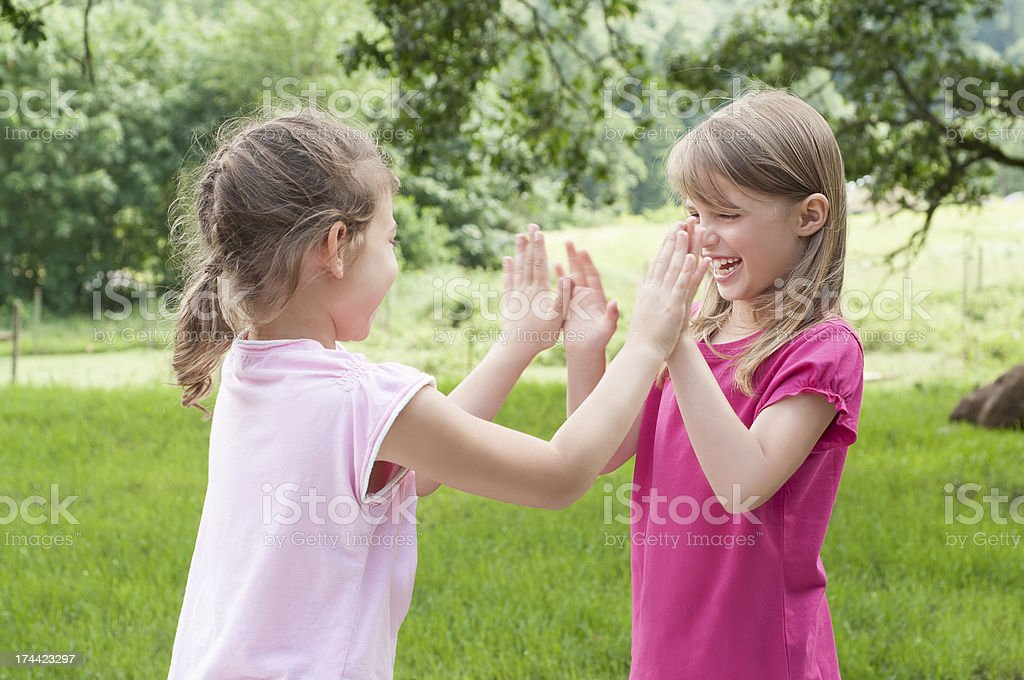 Two Girls Playing Patt-a-cake royalty-free stock photo