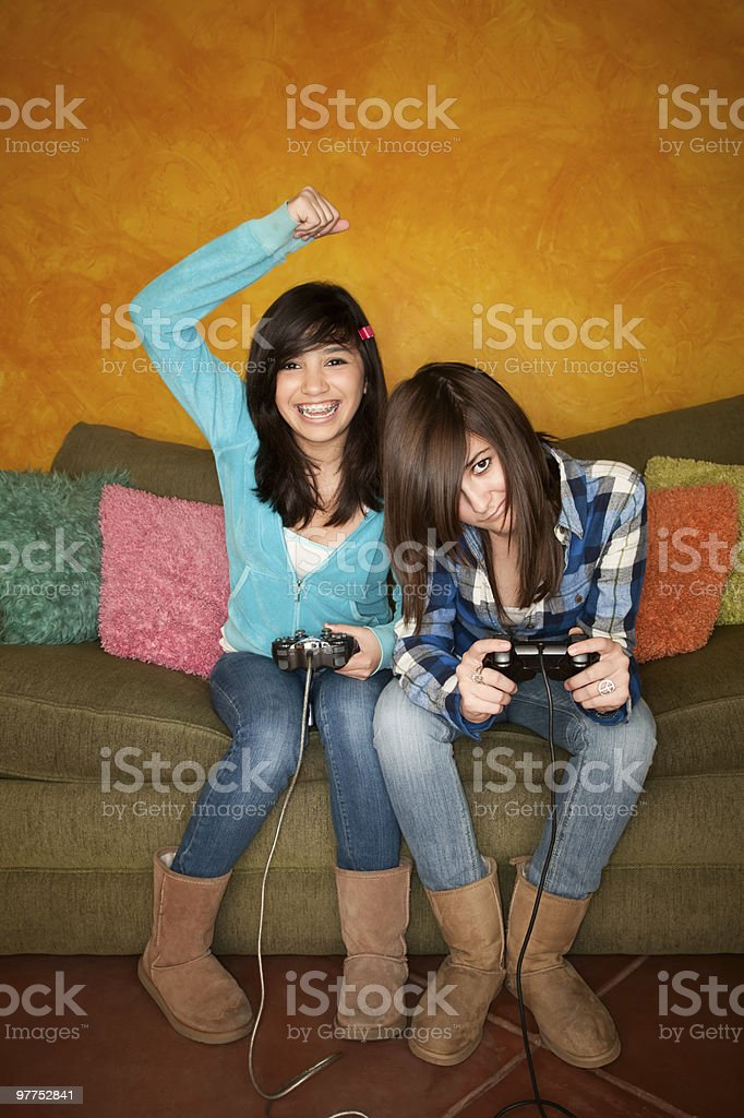 Two girls playing Video game royalty-free stock photo