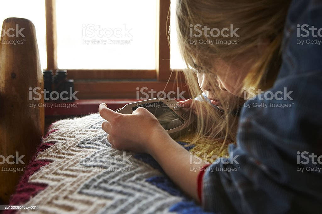 Two girls (4-7) playing video game royalty-free stock photo