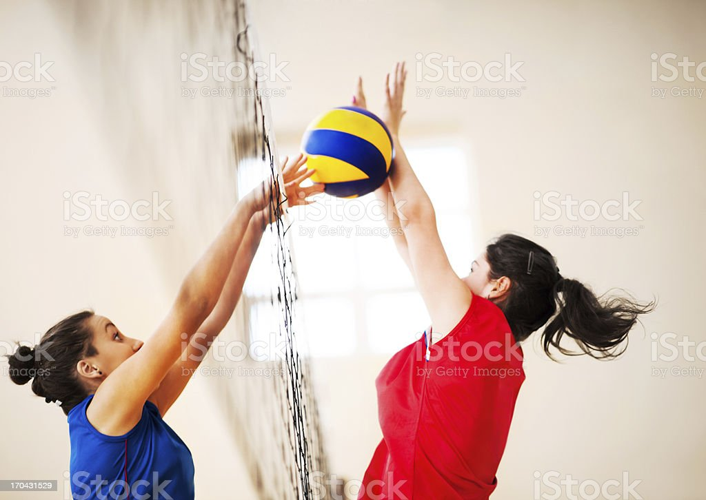 Two girls playing volleyball. royalty-free stock photo