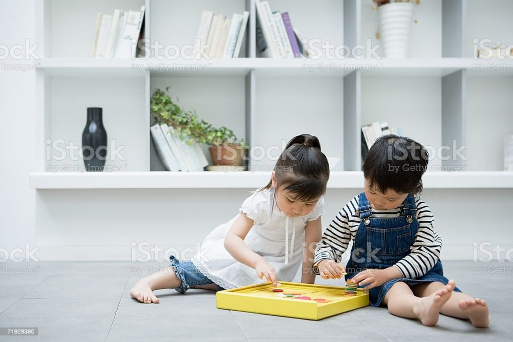 Two girls playing with a toy royalty-free stock photo