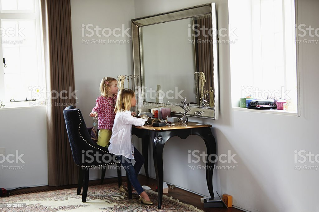 Two Girls Playing With Jewelry And Make Up royalty-free stock photo