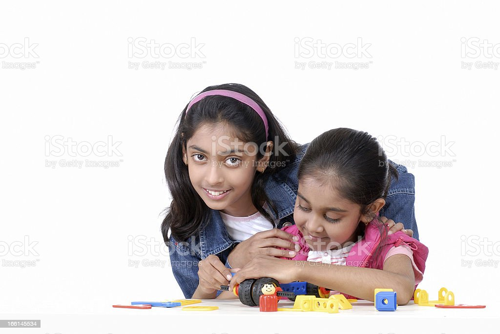 two girls playing with mechanical blocks royalty-free stock photo