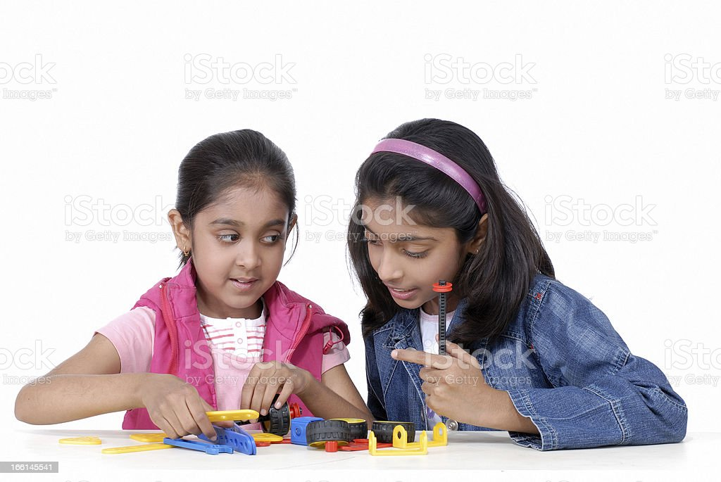 two girls playing with toy blocks royalty-free stock photo