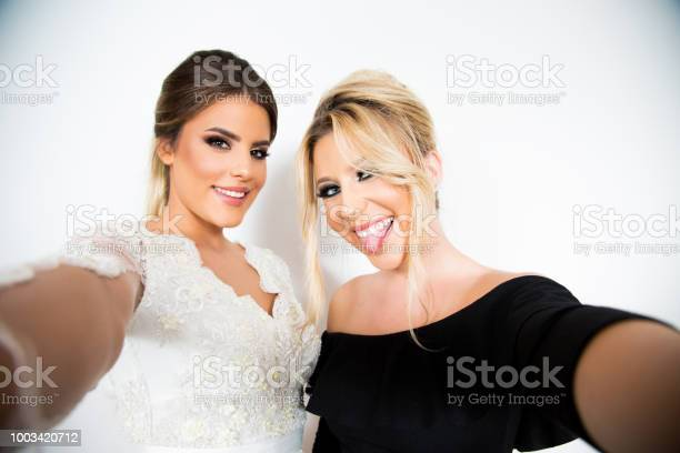 Two girls posing on a white background picture id1003420712?b=1&k=6&m=1003420712&s=612x612&h=b8sxdnq4xrfgevjvgtoz6woiw9vwboucxgxzgnzuloi=