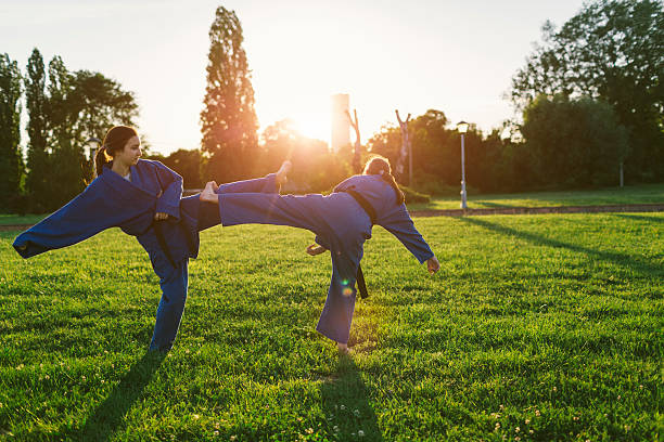 Two Girls  Practicing Aikido stock photo
