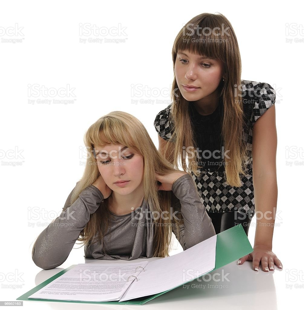 Two girls read documents royalty-free stock photo