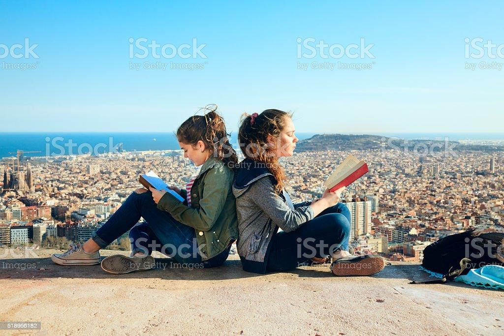 Two girls readingover Barcelona stock photo