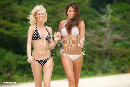 istock Two Girls running down the Beach (XXXL) 157533538