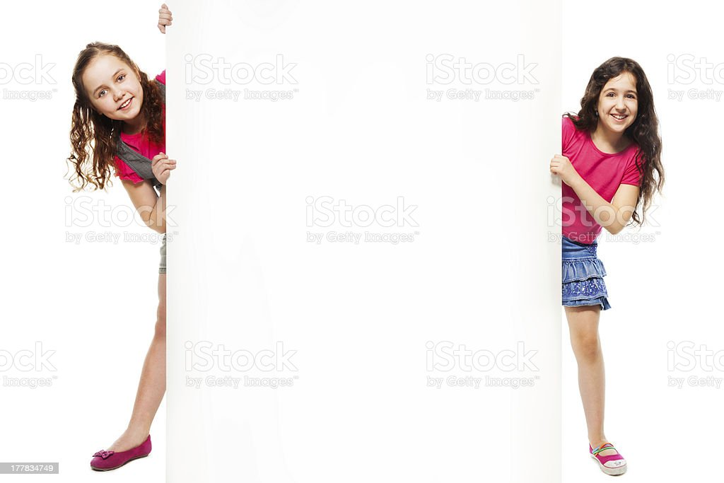 Two girls showing advertising royalty-free stock photo