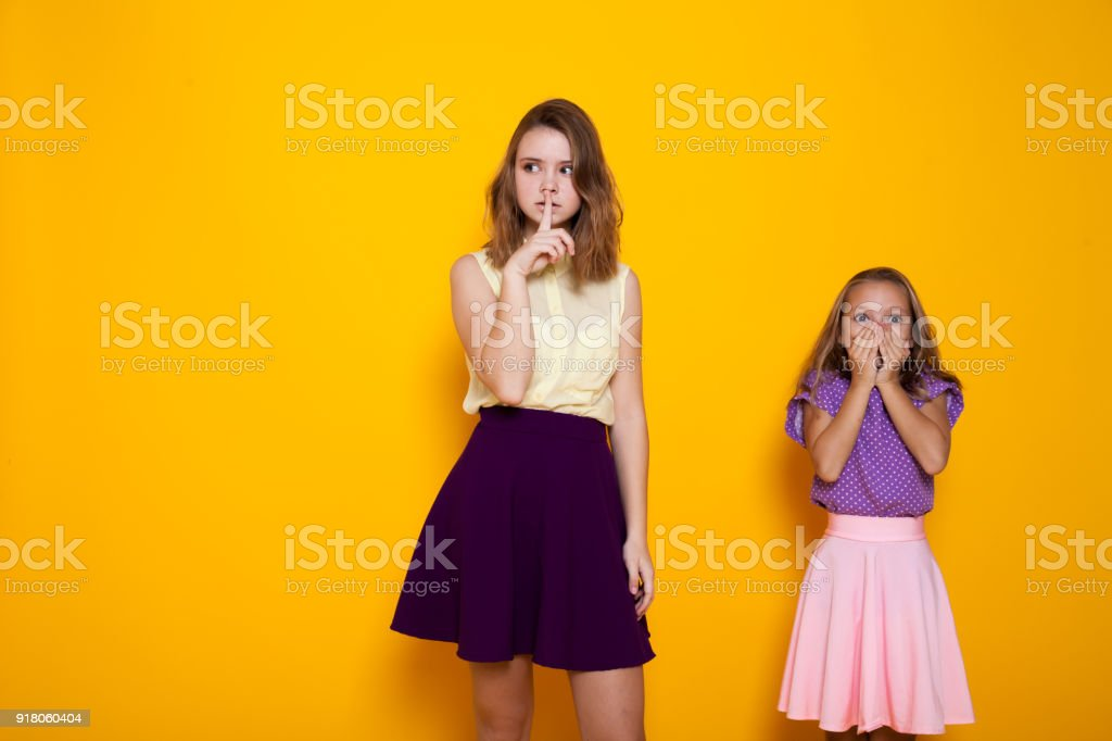 two girls shut his mouth stock photo
